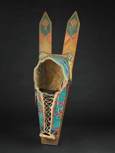 Cradleboard. Kiowa or Comanche people, about 1850-1870. Animal hide, textile, glass beads, tin. Museum purchase with funds provided by the 2004 Museum Dinner and Ball and general acquisition funds, 2005.103.
