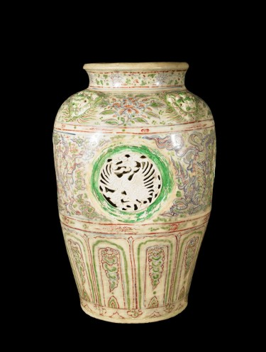 Jar. Vietnamese, 16th century. Glazed stoneware with four monster-head bosses below rim, mythological animals with cloud and flame motifs painted in underglaze-blue cobalt-oxide and overglaze enamels, with inset, reticulated, bisque-fired roundels with cranes. 24 1/4 × 15 inches. Collection of the Art Fund, Inc. at the Birmingham Museum of Art; Purchased with funds provided by the Estate of William M. Spencer III, AFI289.2010.