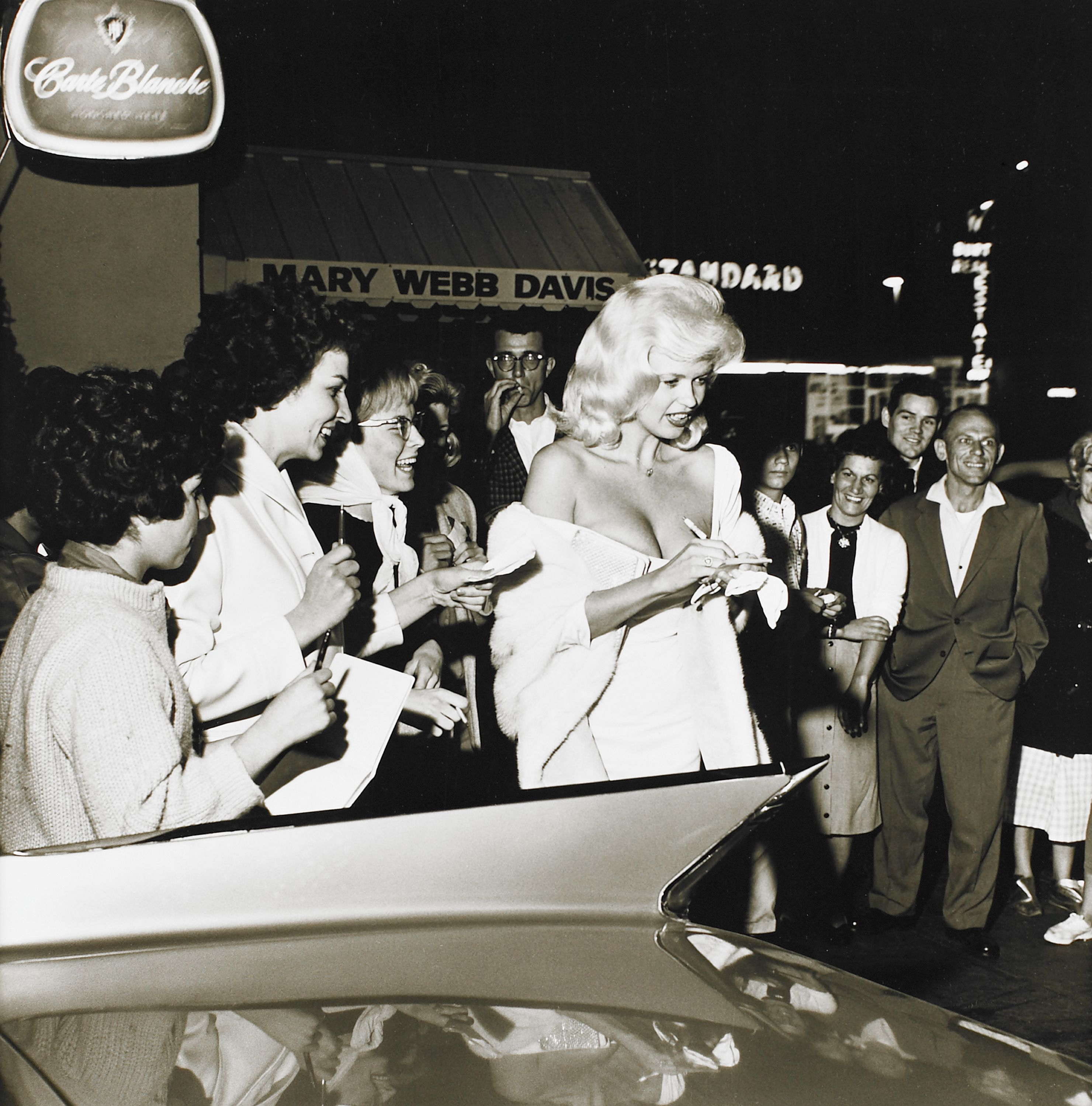 """Jayne Mansfield Signing Autographs"" (1961), Sid Avery, American (1918-2002). Gelatin on silver print. Gift of Ronald Avery. 1990.104.5."