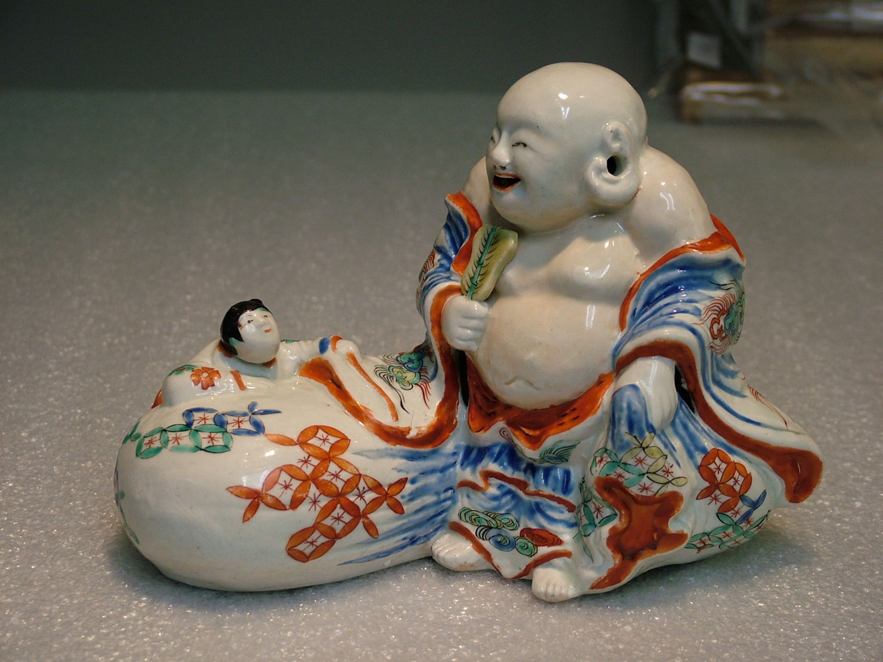 Hotei is a Buddhist folk character who supposedly lived in China during the early 10th century. He is now worshipped in Japan as the God of Good Fortune. // Hotei sculpture, Japan, Edo period (1615-1868), about 1750. Gift of Mr. and Mrs. Bartlett G. Bretz.