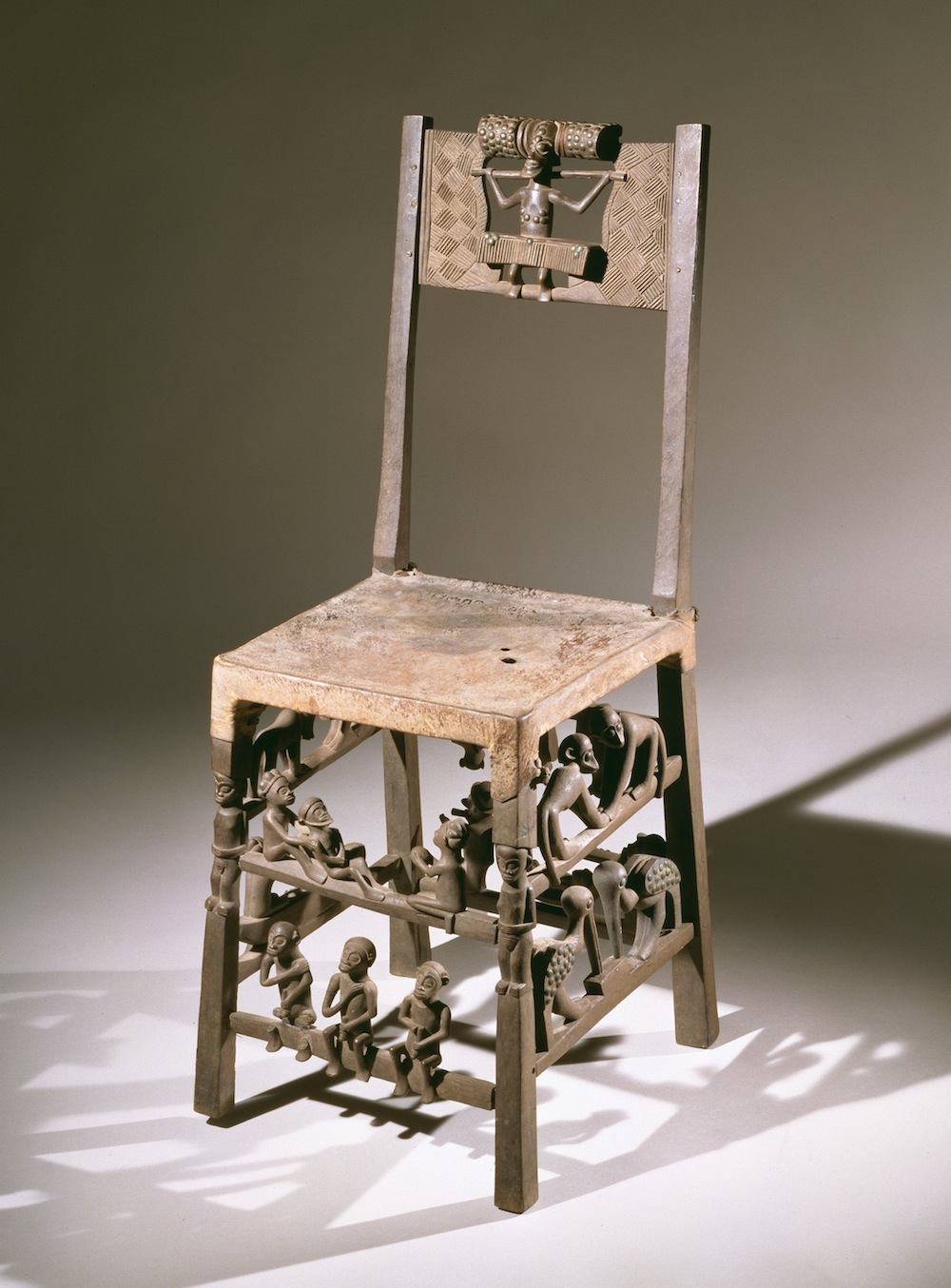 Chief's Chair or Throne, Late 19th or early 20th century, Chokwe people, Angola. Carved wood, animal skin, metal tacks. Gift of Mrs. Rita Judge Smith. 2001.104 .