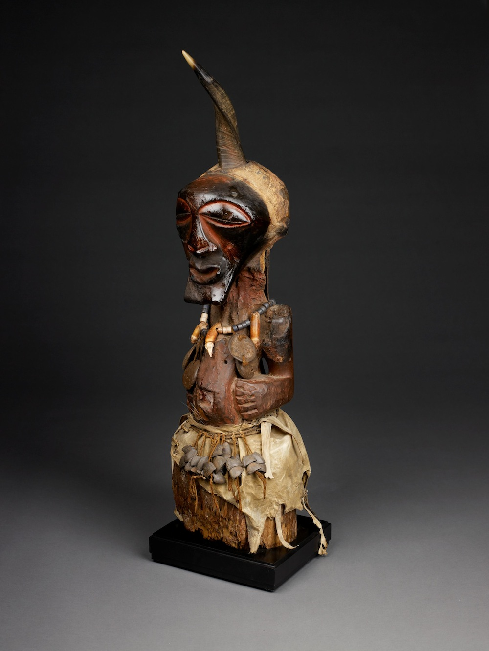 Power figure (nkishi), Early 20th century, Songye people, Democratic Republic of Congo. Wood, animal skin, animal teeth, seed pods, horn, metal, fiber, glass beads. Museum purchase with funds provided by the Birmingham City Council through the Birmingham Arts Commission, and the Endowed Fund for Acquisitions. 1989.64 .