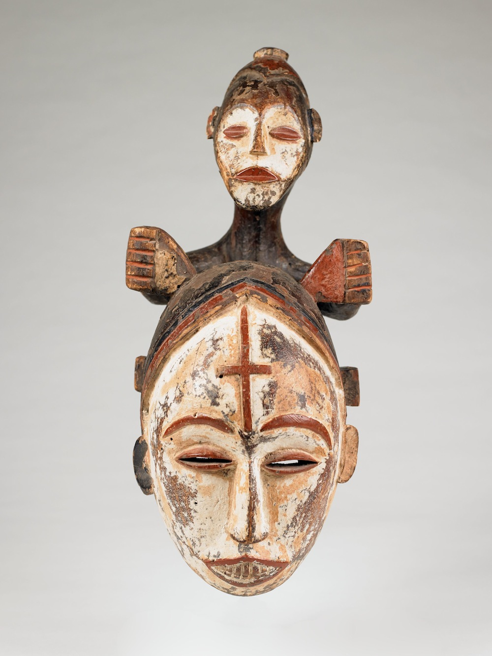 Queen of Women Mask (Eze Nwanyi), Northeastern Igbo people (Ezza or Izzi sub-group), Nigeria. Late nineteenth/early twentieth century. Wood, pigment. Museum purchase with funds given in memory of Mrs. Dorothy Steiner. 2009.3 .