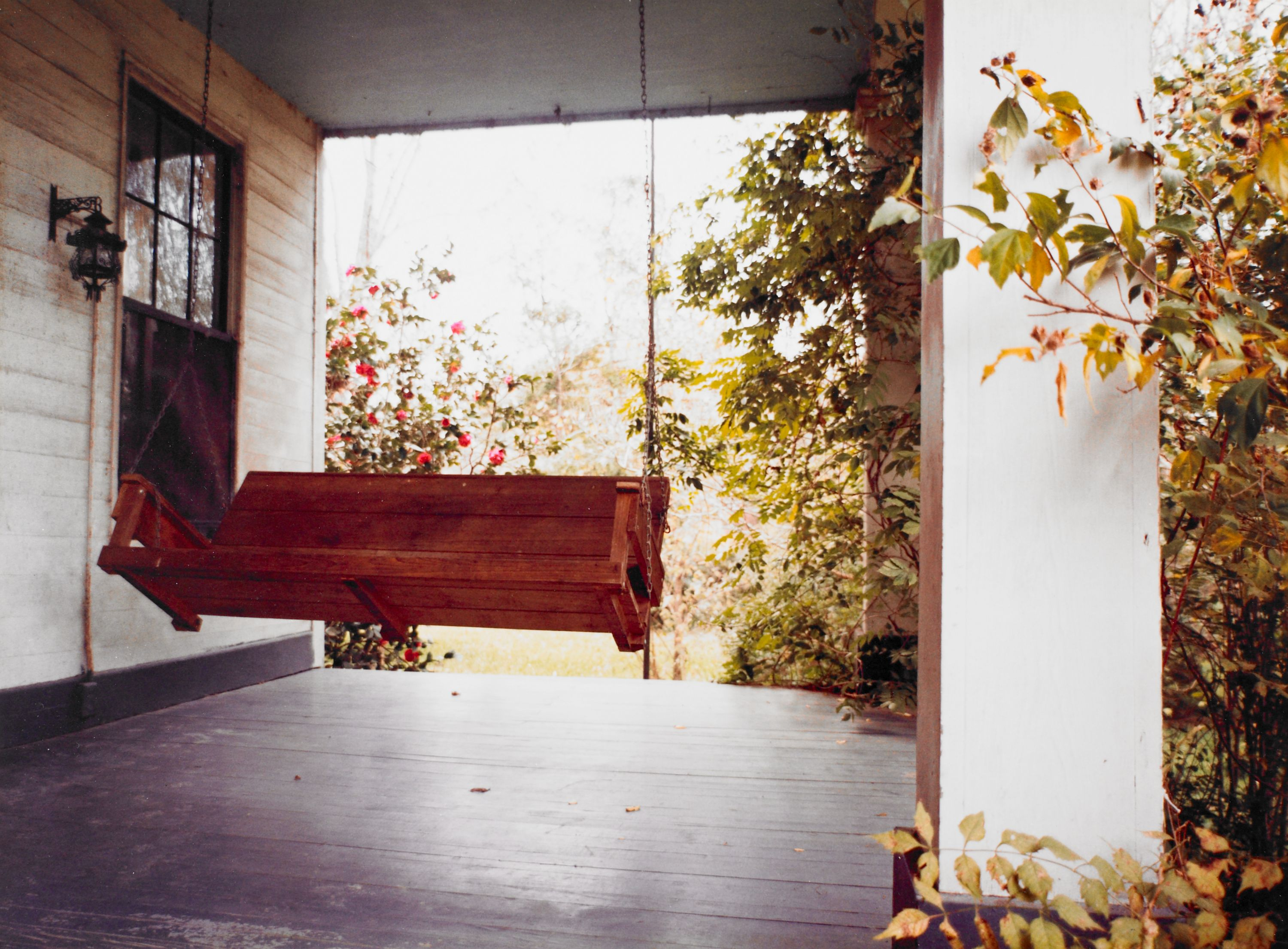 """Front Porch Swing"" William Eggleston, United States, born 1939. BMA Collection 1986.219.1."