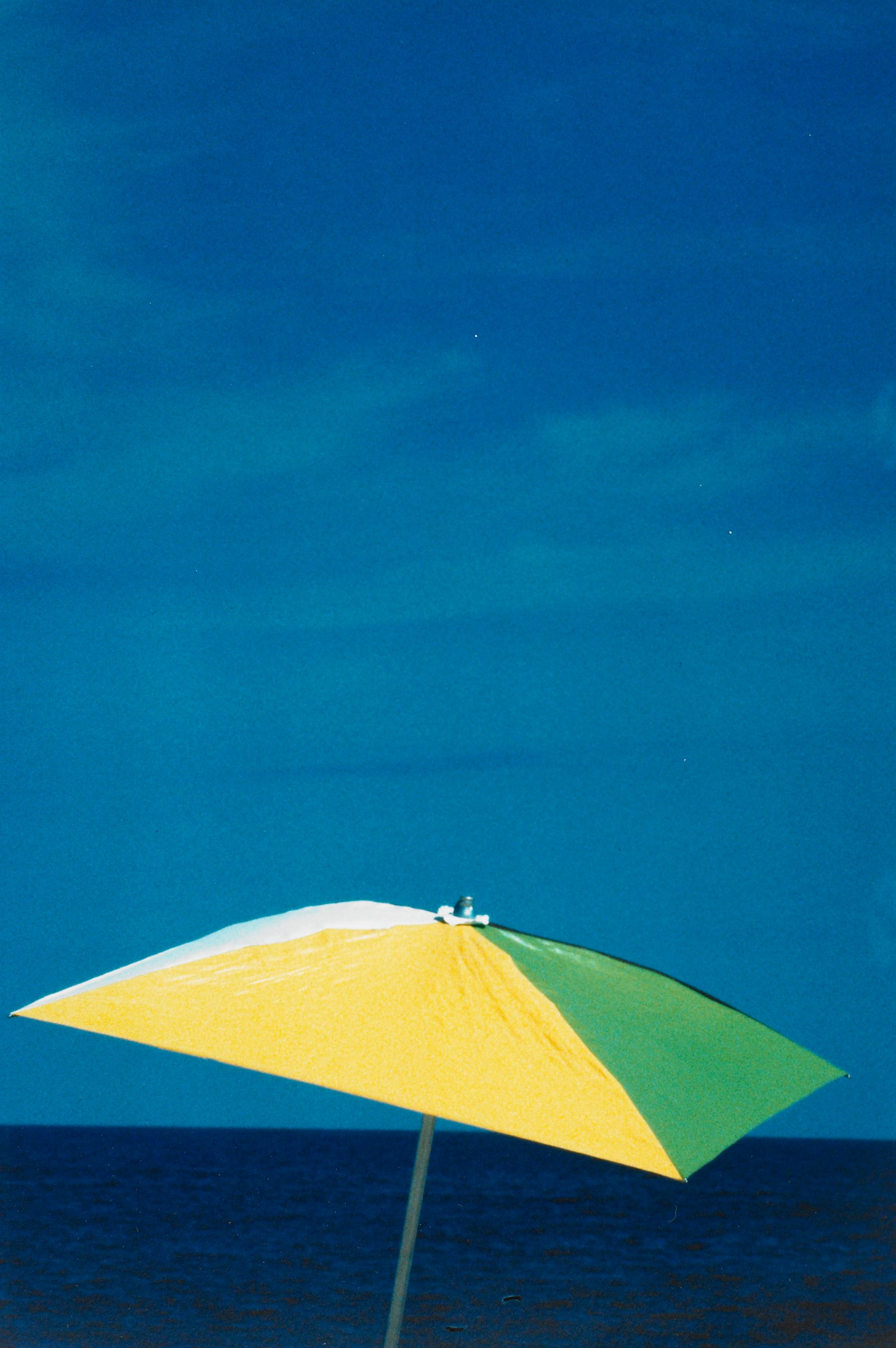 """Untitled (Umbrella on Beach) East Hampton"" Ralph Gibson, United States, born 1939. Type C color print. BMA Collection 1989.212.1."