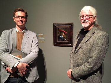 Dr. Schindler and Terry Beckham, Exhibitions Designer, with Vermeer's 'Girl with a Red Hat.'