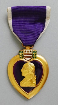 """Purple Heart"" (1932) Designed by Elizabeth Will, American (1899-1975), Modeled by John R. Sinnock, American (1888-1947). Gilt bronze, enamel, and silk. Gift of the family of Kelly Ingram. 1967.250.2."