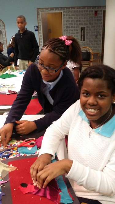 Students at Central Library creating Radcliffe Bailey-inspired pieces.