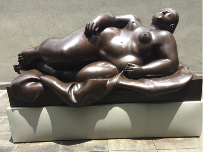 """Need a little sunshine? The sculpture garden is the perfect place to kick back and soak up some sun! // """"Reclining Nude"""" Fernando Botero, bronze. BMA collection 1985.292."""