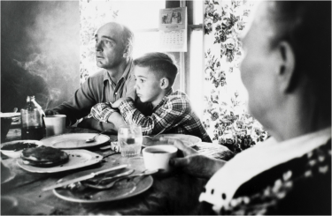 "Erwitt's photo captures a tender moment between the ranch boy and his father. // ""Ranch Boy with Father"" Elliott Erwitt (United States, born France), gelatin silver print, photograph. BMA collection. 22.1990.7."