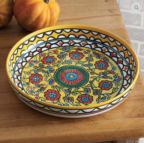 Yellow Floral Bowl ($56) // Intricately hand painted in brilliant jewel-tone colors, these lively floral ceramic bowls includes the signature of the artisan who created it on the front for a truly personal touch.  Handmade in West Bank, Fairtrade.