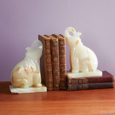 Handmade in Pakistan, these weighty onyx bookends are hand-carved and polished to a smooth finish to create this charming set – with trunks up for good luck! / $78