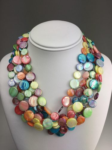 """Make a casual outfit a work of art with our 6-strand """"Candy"""" Necklace. Mother of Pearl, 20 inches.  /  $98."""