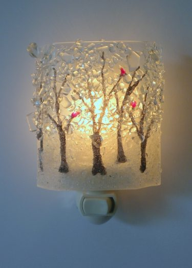 Our assorted night lights will light up the room - in more ways than one! Created in a mosaic style from broken bottle glass, the night lights are then kiln formed and fused. Find your favorite design in the store! / $38.00