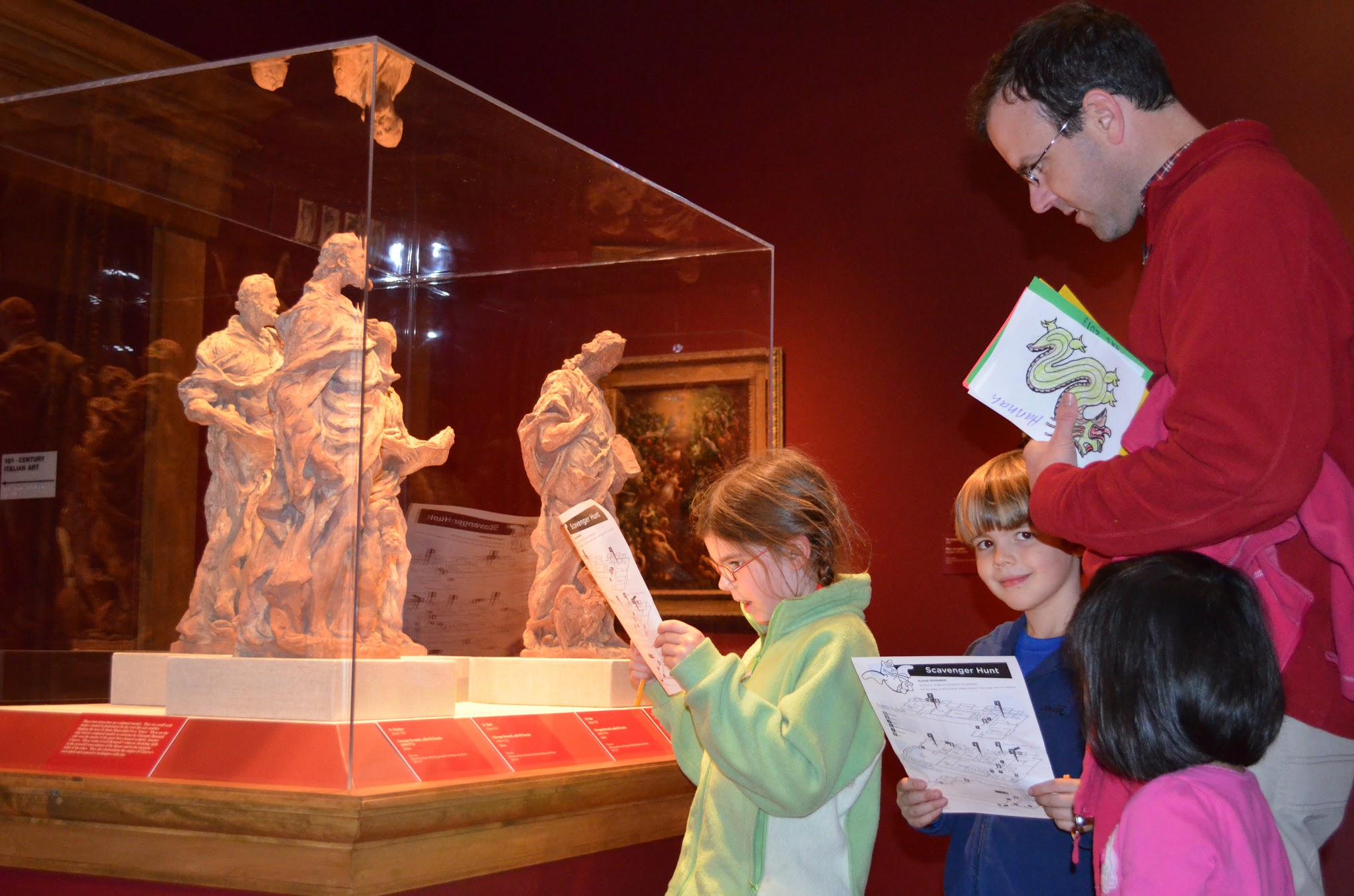 A family viewing sculptures in the gallery.