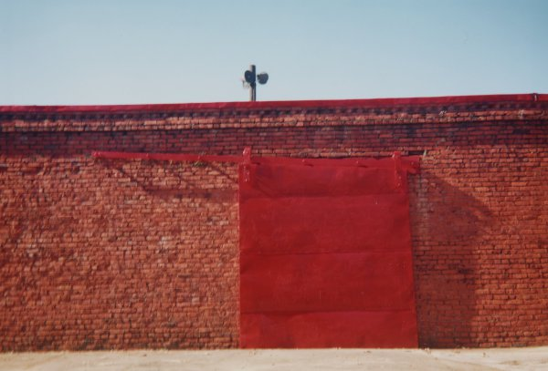 Warehouse Door, Newbern, Alabama, December 1997 December 1997; printed 1998 chromogenic print Gift of Maria and Lee Friedlander 2004.23