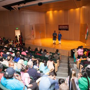 Visitors sitting in the auditorium before the Holi performances.