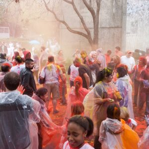 People throwing colored powders during Holi Festival.