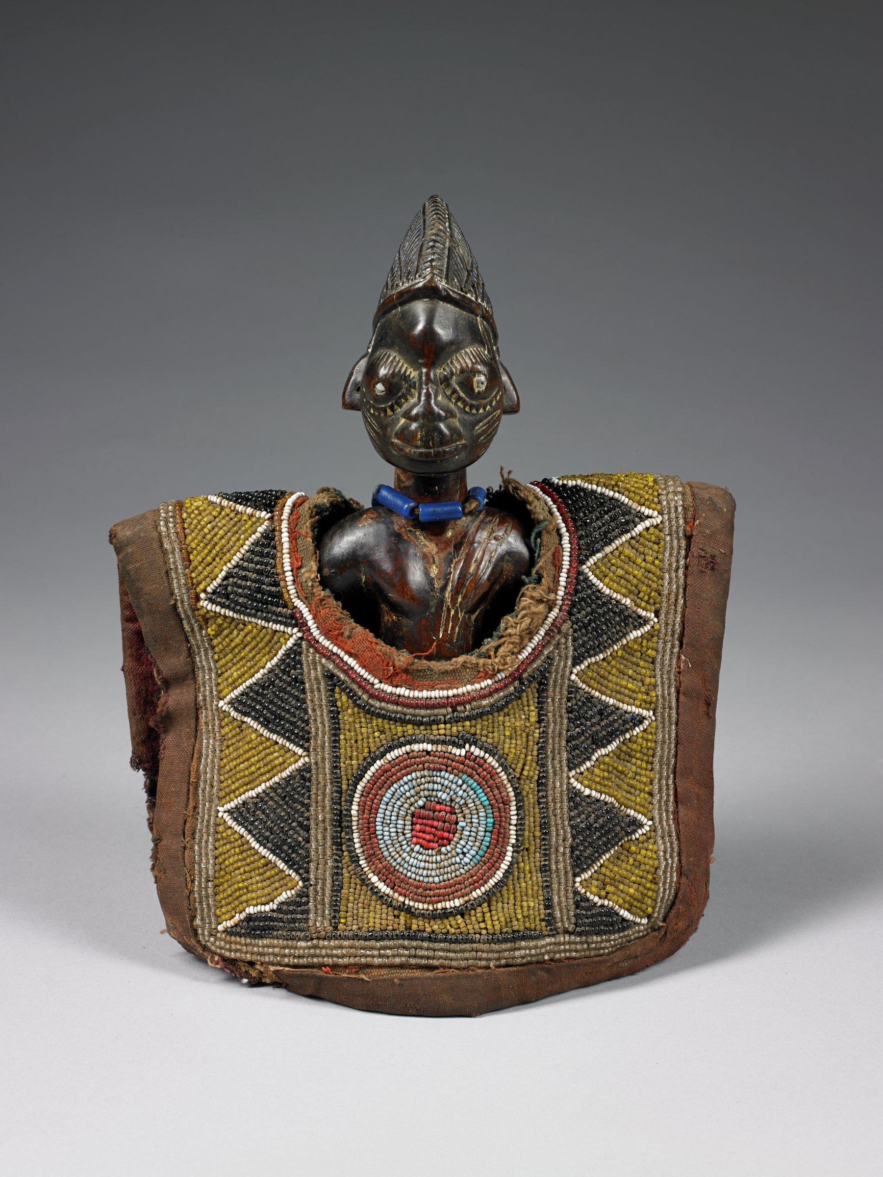 Twin Figure (ere ibeji) 20th century, Yoruba people, Nigeria, wood, fabric, glass beads, thread, Anonymous gift, 1991.975.1-2