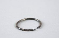 Silver hoop with spiral grooves at ends