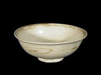 Glazed stoneware bowl with chrysanthemum spray in well and scrolling bands below rim all painted in underglaze iron