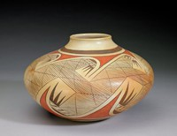 Ceramic--creamy orange slip, painted over with black and orange--hatched panel of hooked wings between parallel bars