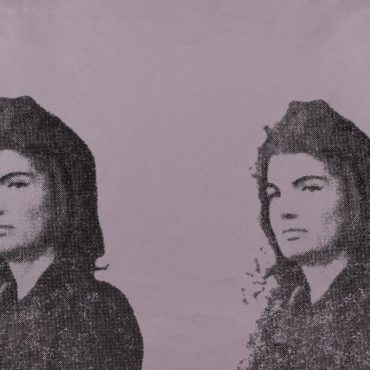 "Photograph of the head and shoulders of Jacqueline Kennedy reproduced twice in black on a lavender background and published in the portfolio ""11 Pop Artists II."""