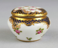 Small round covered box with floral decoration and gilding.