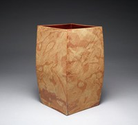 Square vessel slightly irregular in form of marbleized stoneware in shades of mottled reddish brown, the interior covered with a brown glaze.