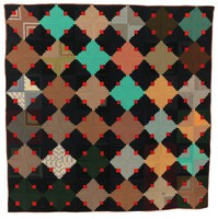 """Brown satin-backed bed quilt in the """"log cabin"""" pattern pieced of wool in shades of green, blue, herringbone, pinstripe, gray, beige, and black, some fabrics patterned, some not, with red block squares"""