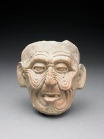 Modeled head of Old God (Huehueteotl) with sagging cheeks, wrinkled brow, drooping eyelids, prominent ears, open mouth with missing front teeth, protruding tongue.