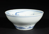 Porcelain blue and white bowl with dragons in interior