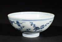 Porcelain blue and white bowl with abstract character in interior