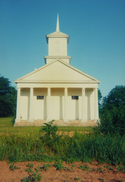 Church across Early Cotton, Pickinsville, Alabama, 1964, William Christenberry, chromogenic print