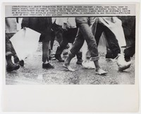 "Press print with caption ""(SEX-6) SELMA, ALA., MARCH 23--MARCHING FEET IN CIVIL RIGHTS PROTEST -- Feet, some bare, some in tennis shoes, some in combat boots, wrapped in plastic, some in rubber boots, all move over a rain-soaked highway in today's third lap of the civil rights march on Alabama's capital at Montgomery. The march, in protest of voting rights, is scheduled to end Thursday. (APWirepho / (SEE AP WIRE STORY) (wfa 2 1310 stf)1965"""