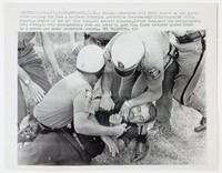 """Black and white press print of two white policemen struggling to hold down a white male in the grass. Two more policemen stand behind the struggle. Includes caption """"Crawfordville, Ga.: Georgia patrolmen hold Cecil Meyers on the ground after pulling him from a Southern Christian Leadership Conference (SCLS) photographer 10/12. Meyers, a member of the Klu Klux Klan, and another Klansman, Howard Sims, told the photographer, Brig Crabe, to stop photographing them and tried to grab him. State troopers placed Crabe in a patrol car under protective custody. UPI Telephoto.tfs"""""""
