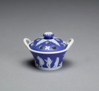 Miniature covered potpourri pot of white jasper with dark blue jasper dip and white relief decoration, the body basket shaped with two extended loop handles, the interior is glazed, the exterior of the body decorated with two small relief scenes separated by trees, small flowering plants and a ewer, on one side Bellerophon watering Pegasus and on the other a group of warriors, the perforated cover with small floral motifs and acanthus leaves radiating out from the mushroom finial.