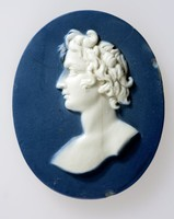 Oval dark blue jasper medallion with white relief profile portrait of an unknown man