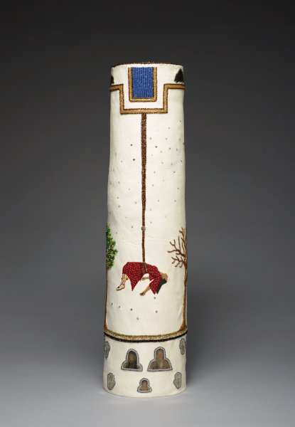 Cylindrical vessel with painted, rawhide interior and tanned white deer hide exterior; beaded imagery includes woman dangling from rope and two trees; stars and constellations in Swarovski crystals; porcupines, hands, ants, and portrait heads are in silver.