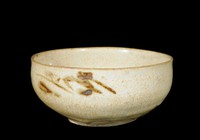 Bowl with floral shapes painted in underglaze iron.