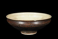 Bowl with ivory glaze in well.