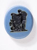 Oval blue jasper Nicolo intaglio with black figures of Venus and Cupid