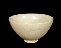 Deep bowl with carved floral pattern in well, lotus petals on exterior, and ivory glaze