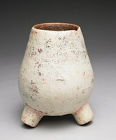 Pear-shaped, tri-footed, burnished, earthenware jar with creamy-white slip; traces of red pigment in banded patterns around body of vessel and legs - pigment appears to have been removed.