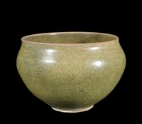 Inverted bowl with everted rim, with low-fired moss-green glaze and five small spurmarks in well