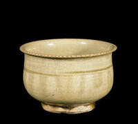 Bowl with everted serrated rim, with brown-olive glaze pooled in well and at foot