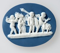 Oval dark blue jasper plaque with white relief of the Marriage of Cupid and Psyche.  The subject was originally taken from a Renaissance gem, a sardonyx, then in the Marlborough collection and now in the Museum of Fine Arts, Boston. There are three known versions of the Marriage of Cupid and Psyche all taken from the original Marlborough gem.