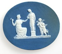 Oval dark blue jasper plaque with white relief scene depicting Pygmalion creating the statue that is eventually brought to life by Aphrodite.