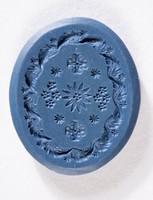 Oval blue jasper intaglio with floral designs