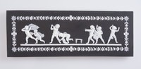 Rectangular black jasper plaque with white relief scene of Blind Man's Bluff modelled by John Flaxman. This bas relief was first modelled by John Flaxman Jnr in 1782, as a direct response to Wedgwood's request for: 'Some groups of children, proper for bas reliefs to decorate the side of Tea pots.' Four drawings were originally sent to Wedgwood, one of which was entitled 'Blind Man's Buff'.
